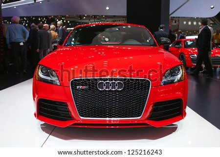 DETROIT - JANUARY 14 : An Audi TT RS on display at The North American International Auto Show  January 14, 2013 in Detroit, Michigan. - stock photo