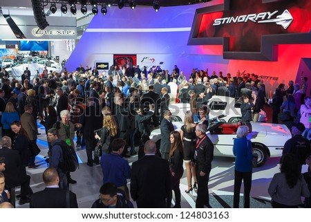 DETROIT - JANUARY 14 :Members of the media take a look at the new Corvette C7 Stingray at The North American International Auto Show  January 14, 2013 in Detroit, Michigan. - stock photo