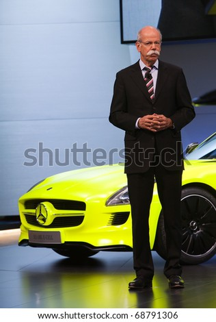 DETROIT - JANUARY 10: Mercedes Benz Chairman Dieter Zetsche introduces the new E-Cell at the 2011 North American International Auto Show Press Preview on January 10, 2011 in Detroit, Michigan. - stock photo