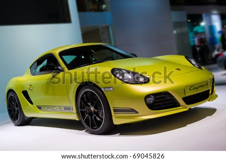 DETROIT - JANUARY 13: Porsche Cayman R at the 2011 North American International Auto Show Industry Preview on January 13, 2011 in Detroit, Michigan. - stock photo