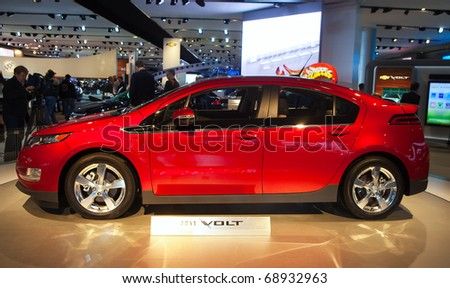DETROIT - JANUARY 11: The Chevy Volt electric car at the 2011 North American International Auto Show Press Preview on January 11, 2011 in Detroit, Michigan. - stock photo