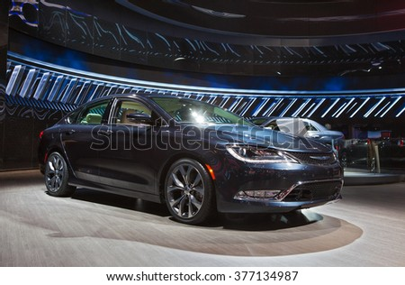 DETROIT - JANUARY 11: The 2017 Chrysler 200 on display at the North American International Auto Show media preview January 11, 2016 in Detroit, Michigan. - stock photo