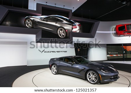 DETROIT - JANUARY 15 : The 2014 Corvette Stingray on display at The North American International Auto Show  January 15, 2013 in Detroit, Michigan. - stock photo