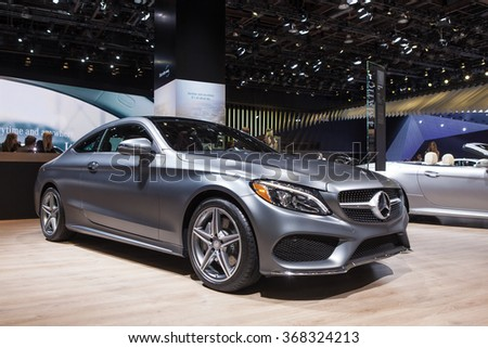 DETROIT - JANUARY 12: The 2016 Mercedes Benz C300 Coupe on display at the North American International Auto Show media preview January 12, 2016 in Detroit, Michigan. - stock photo