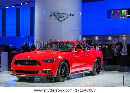 DETROIT - JANUARY 14 : The new 2015 Ford Mustang on display at the North American International Auto Show media preview  January 14, 2014 in Detroit, Michigan. - stock photo