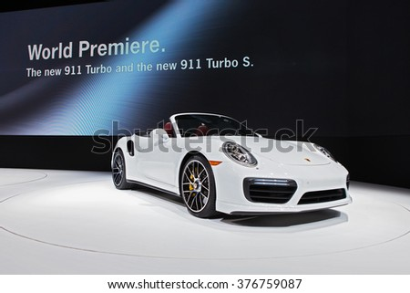 DETROIT - JANUARY 11: The Porsche 911 Turbo on display at the North American International Auto Show media preview January 11, 2016 in Detroit, Michigan. - stock photo