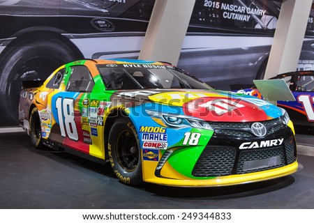 DETROIT - JANUARY 13:The Toyota M&M Camry NASCAR on display January 13th, 2015 at the 2015 North American International Auto Show in Detroit, Michigan. - stock photo