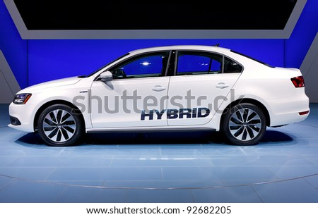 DETROIT - JANUARY 11: The 2012 Volkswagen Jetta hybrid at the 2012 North American International Auto Show Industry Preview on January 11, 2012 in Detroit, Michigan. - stock photo