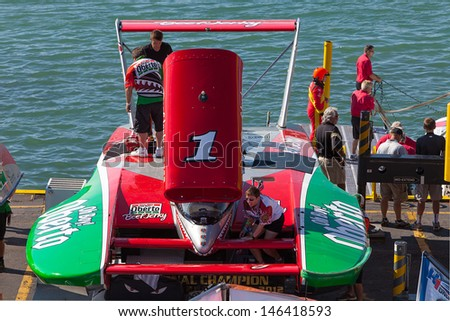 DETROIT - JULY 13: The Oh Boy Oberto hydroplane prepares for testing at the APBA Gold Cup July 13, 2013 on the Detroit River in Detroit, Michigan. - stock photo