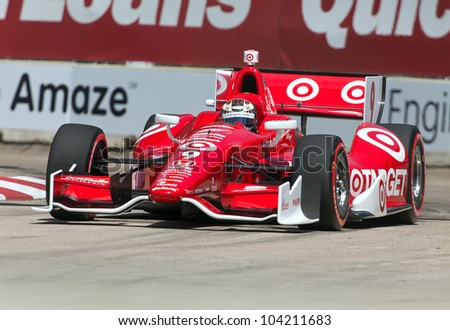 DETROIT - JUNE 2: The Target Indy car races out of a corner at the 2012 Detroit Grand Prix on June 2, 2012 in Detroit, Michigan. - stock photo