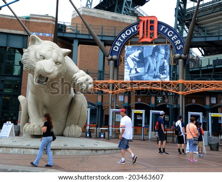 DETROIT, MI - JULY 6: Fans walk near the entry of Comerica Park, home of the Detroit Tigers, on July 6, 2014. The Tigers lost to the Tampa Bay rays that night 7-3.  - stock photo