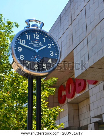 DETROIT, MI - JULY 6: One of the four Shinola City Clocks in Detroit, MI, is shown near Cobo Center on July 6, 2014. The clocks were donated by the Shinola company as a show of support for the city.  - stock photo
