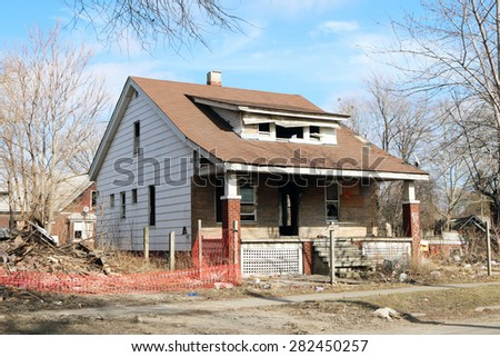 DETROIT, MI-MAY, 2015:  Abandoned and damaged single family home near downtown Detroit.   - stock photo