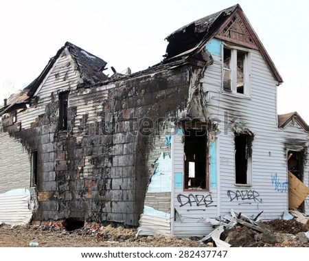 DETROIT, MI-MAY, 2015:  Abandoned and fire damaged single family home near downtown Detroit.   - stock photo