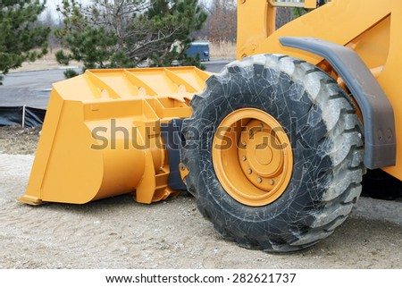 DETROIT, MI-MAY, 2015:  Close up of the scoop on an end loader at a construction site.   - stock photo
