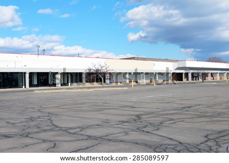 DETROIT, MI-MAY, 2015:  Parking lot at an abandoned strip mall, less than 10 miles from downtown Detroit.  - stock photo