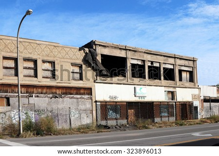 DETROIT, MI-OCTOBER, 2015:  Deserted commercial buildings along one of Detroit's major streets. - stock photo