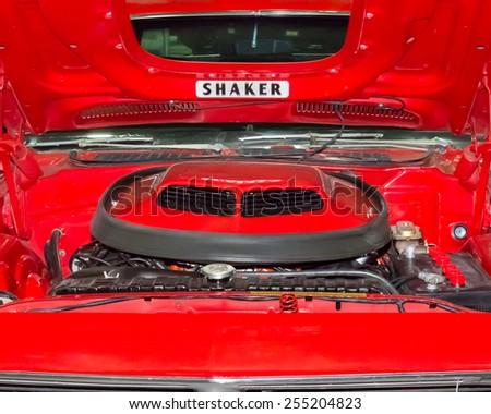 DETROIT, MI/USA - MARCH 9, 2014: 1970 Plymouth Hemi 'Cuda (Barracuda) Shaker hood scoop, on display at the Detroit Autorama. - stock photo