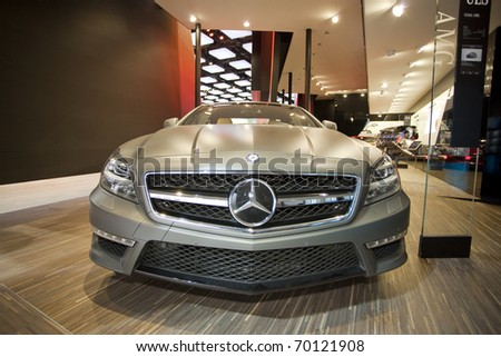 DETROIT, MICHIGAN - JANUARY 18: A new CLS63 AMG Mercedes Benz is on display at the 2011 North American International Auto Show on January 18, 2011 in Detroit, Michigan. - stock photo