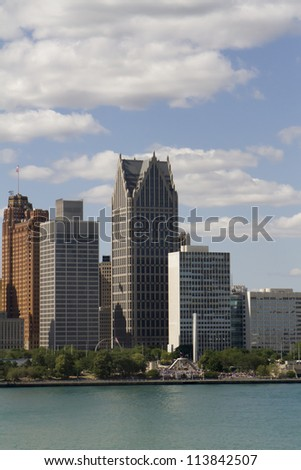 Detroit Michigan USA skyline as seen across the Detroit River. - stock photo