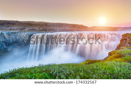Dettifoss is the most powerful waterfall on Iceland and in the whole Europe. It is located in Jokulsargljufur National Park the northeasten Iceland on the river Jokulsa a Fjollum. - stock photo
