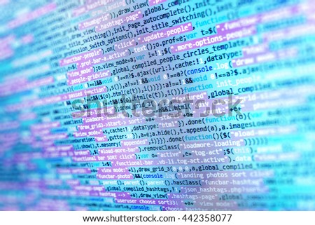 Developer working on websites codes in office. Software background. Monitor photo.  Website codes on computer monitor. Programming code on computer screen.  Software source code.   - stock photo