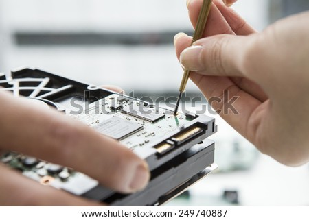 Developers who are working to bring a pair of tweezers - stock photo