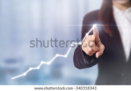 Development and growth concept. Businessman plan growth and increase of positive indicators in his business. - stock photo