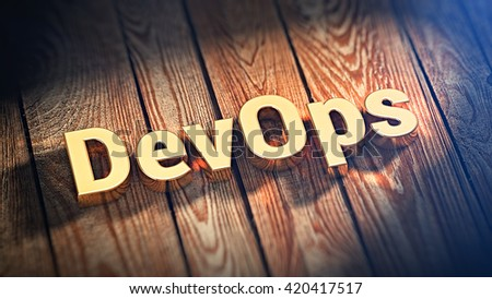 """Development operations. The word """"DevOps"""" is lined with gold letters on wooden planks. 3D illustration image - stock photo"""
