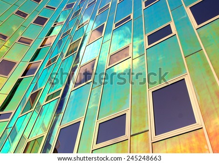 DEVENTER,NETHERLAND - December 19:Office building Larc en Ciel on Dec.19, 2014  Deventer,Netherland .When the sun shines on the glass it turns into different colors  what gives a spectaculair result  - stock photo