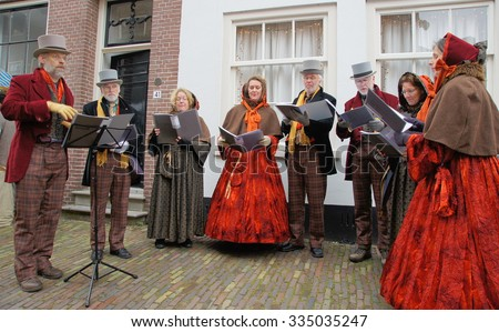 DEVENTER - NETHERLANDS ; Costumed participants at the Dickens Festival on 21 december 2014 , are singing Christmas carols to the more than 150.000 persons visiting this event.   - stock photo