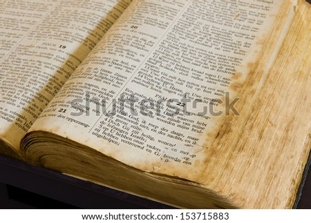 DEVENTER, NETHERLANDS - MARCH 16: Old dutch bible on march 16, 2013 in deventer, netherlands. The first dutch bible directly translated from the hebrew and greek texts appeared in 1637. - stock photo