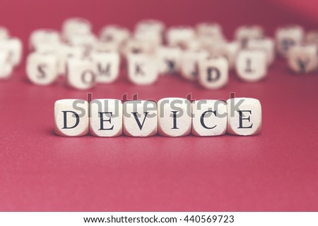 Device word written on wood cube with red background - stock photo
