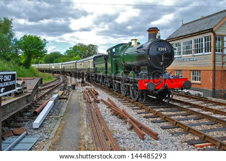 DEVONSHIRE - JUNE 10: Classic train at Totnes on the South Devon Railway, a seven mile former Great Western Railway branch line built in 1872. June 10, 2013 in Devonshire, England. - stock photo