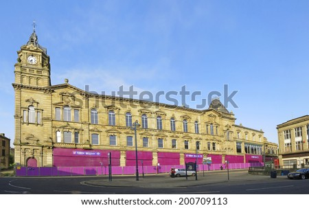 DEWSBURY, UK - JUNE 20: Commercial buildings, Dewsbury, West Yorkshire, England, UK, 20 June 2014. Dewsbury, after a period of decline, is redeveloping derelict mills and regenerating city areas.  - stock photo