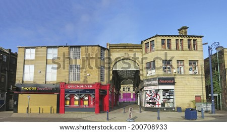 DEWSBURY, UK -JUNE 16: Queen's Arcade, Dewsbury, West Yorkshire, England, UK, 16 June 2014. Dewsbury, after a period of decline, is redeveloping derelict mills into flats and regenerating city areas.  - stock photo