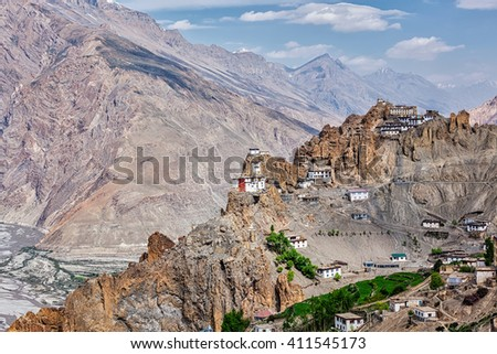 Dhankar gompa Buddhist monastery on cliff and Dhankar village in Himalayas, Dhankar, Spiti valley, Himachal Pradesh, India - stock photo