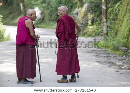 DHARAMSALA, INDIA - SEPTEMBER 20, 2014: Two old unidentified Tibetan Buddhist monk in the Dharamsala near Dalai Lama's residence. - stock photo