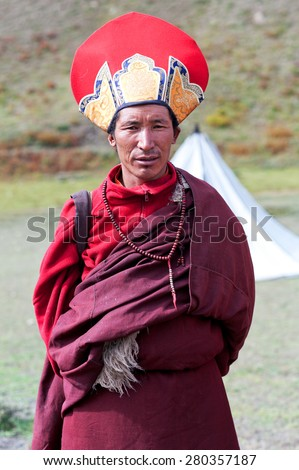 DHO TARAP, NEPAL - SEPTEMBER 11: Tibetan buddhist monk in national clothesl poses for a photo during Full Moon festival on September 10, 2011 in Dho Tarap village, Upper Dolpo, Nepal - stock photo