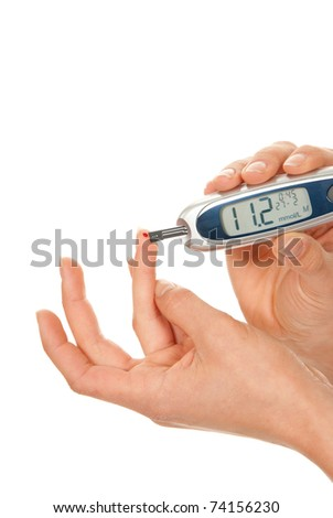 Diabet patient measuring glucose level blood using glucometer test isolated on a white background. High blood sugar hyperglycemia - stock photo