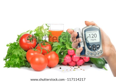 Diabetes concept glucose meter in hand and healthy organic food - stock photo