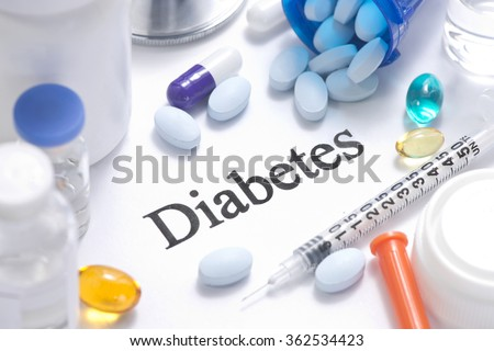 Diabetes concept with insulin, syringe, vials, pills, and stethoscope. - stock photo
