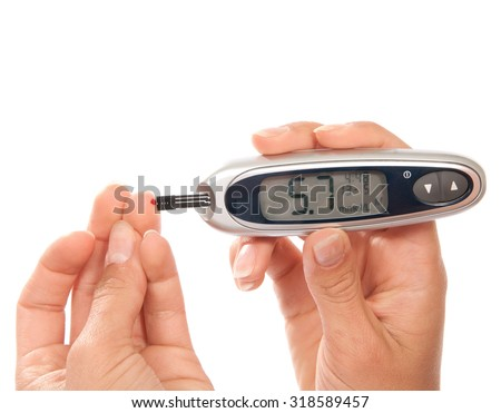 Diabetes patient measuring glucose level blood test using ultra mini glucometer and small drop of blood from finger and test stripsand device showing  5.7  - stock photo