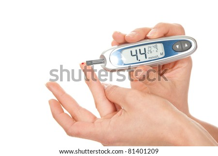 Diabetes patient measuring glucose level blood test using ultra mini glucometer and small drop of blood from finger and test strips - stock photo