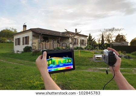 Diagnosis and control of heat loss of a building - stock photo