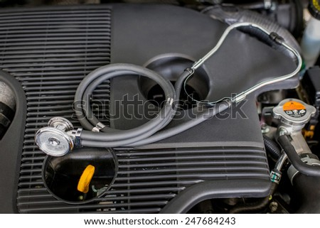 Diagnosis engine at service station - stock photo