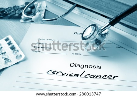 Diagnostic form with diagnosis cervical cancer and pills. - stock photo