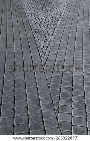 Diagonal lines and gray paving stones of the pavement in the city - stock photo