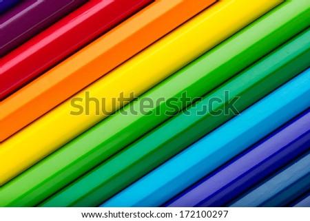 Diagonal row of colorful pencils - stock photo