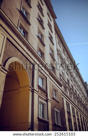 Diagonal view of a facade of an old building with lot of windows - stock photo